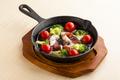 料理メニュー写真タコとトマトのアヒージョ(バケット付き)