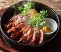 料理メニュー写真アンガス牛のステーキ ~特製オニオンソース~