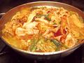 料理メニュー写真鶏と豚バラ肉のチゲ