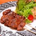 料理メニュー写真黒毛和牛串焼(2本)
