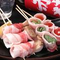 料理メニュー写真黒豚バラ巻き串(三本)