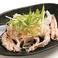料理メニュー写真せせりポン酢~ねぎ生姜のせ~/牛すじと山形豚の辛味噌煮込み