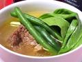料理メニュー写真牛テールピーナッツ煮込み/牛バラ肉と野菜のブイヨンスープ