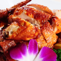 料理メニュー写真鶏半羽の古方法揚げ