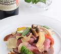 料理メニュー写真黒毛和牛のローストビーフ はちみつとガーリックのソース