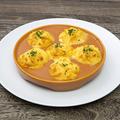 料理メニュー写真とろーりチーズオムレツ ~カニのビスクソース~