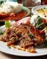 料理メニュー写真豚肩ロース肉のロースト オニオンペッパーソース