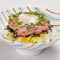料理メニュー写真温玉ねぎとろ丼<定番海鮮丼4種>