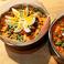 料理メニュー写真サルトゥ・ディ・リゾ(豚肉、ポルチーニ、茹で卵、モッツァレラを包んだリゾット