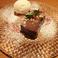 料理メニュー写真トルタカプレーゼ(アーモンド入り濃厚チョコケーキ) バニラジェラート添え