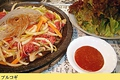 料理メニュー写真プルコギセット(特製ダレをからめた牛肉と野菜の石焼)