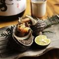 料理メニュー写真地酒のサザエ壺焼き