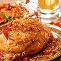 料理メニュー写真名物(3)丸鶏ハーブのから揚げ