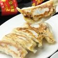 料理メニュー写真肉汁たっぷりの焼き餃子
