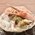 料理メニュー写真かに味噌たっぷり蟹甲羅焼き