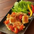 料理メニュー写真広島産ハーブ鶏のトマトガーリック焼き