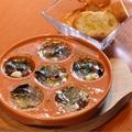 料理メニュー写真エスカルゴとホタテとタコのガーリックバターオーブン香草焼き