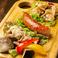 料理メニュー写真肉焼き3種 (塩ホルモン・ヤゲン軟骨・ソーセージ)