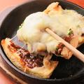 料理メニュー写真マーボー栃尾ピザ