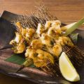 料理メニュー写真つぶ貝の黒煎り七味焼き