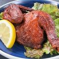 料理メニュー写真ひな鶏の半身揚げ