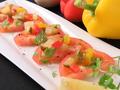 料理メニュー写真トマトスライス ラヴィゴットソース添え