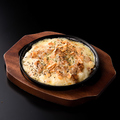 料理メニュー写真鶏そぼろのポテトチーズ焼き