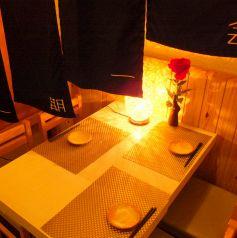 女子会にも会社仲間にピッタリのテーブル席梅田 肉の寿司 和食 足立屋