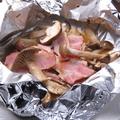 料理メニュー写真きのことベーコンのホイル包焼