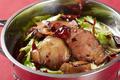 料理メニュー写真キャベツと湖南燻製肉の辛口鍋