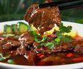 料理メニュー写真牛肉スライスと野菜の辛塩煮込み