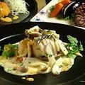料理メニュー写真アワビと鮮魚のワイン蒸し 2色ソース