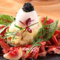 料理メニュー写真17ヶ月熟成ハモンセラーノとトリュフ入ポテトサラダ