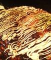料理メニュー写真べた焼き 生卵のせ