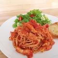 料理メニュー写真エビと道産ホタテを使用したトマトパスタプレート