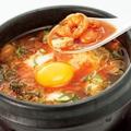 料理メニュー写真海鮮キムチの豆富チゲ / ユッケジャンスープ
