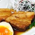料理メニュー写真芋焼酎の豚の角煮~半熟煮玉子と~