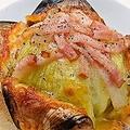 料理メニュー写真玉葱の丸ごとオーブン焼き・とろっとチーズがけ