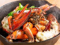 料理メニュー写真丸ごと一尾オマール海老のアヒージョ!