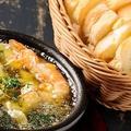 料理メニュー写真つぶ貝とエビのアヒージョ