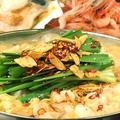料理メニュー写真至高の海老ダシもつ鍋(味噌・辛味噌・醤油・塩)