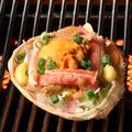 料理メニュー写真カニとウニの甲羅焼き