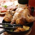 料理メニュー写真丸鶏の炭火壷焼きロティサリーチキン ハーフ