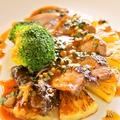 料理メニュー写真伊産イベリコ豚のグリル(さわやかバジルのソース)