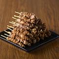 料理メニュー写真ぐるぐる鶏皮串(5本)