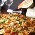 料理メニュー写真ベーコンとオニオンのタルトフランベ Petite(S)サイズ