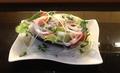 料理メニュー写真焼きナスの海鮮マリネ風サラダ(トマト・レタスなども使用!)