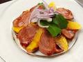 料理メニュー写真鴨のスモークロースと~オレンジソースがけ~