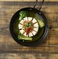 料理メニュー写真カマンベールと明太子のアヒージョ