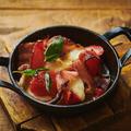 料理メニュー写真まるごとトマトとベーコンのチーズグリル